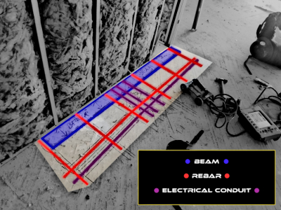 GPR scanning inside of metal track to locate electrical conduit for coring holes in elevated concrete slabs.